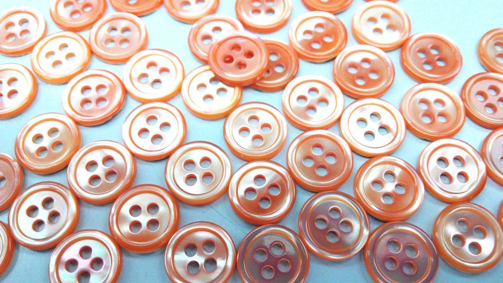 dyed orange pearl shirt buttons